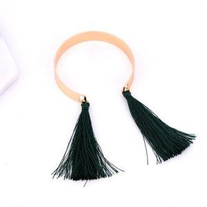 Gold adjustable bangle with green tassel